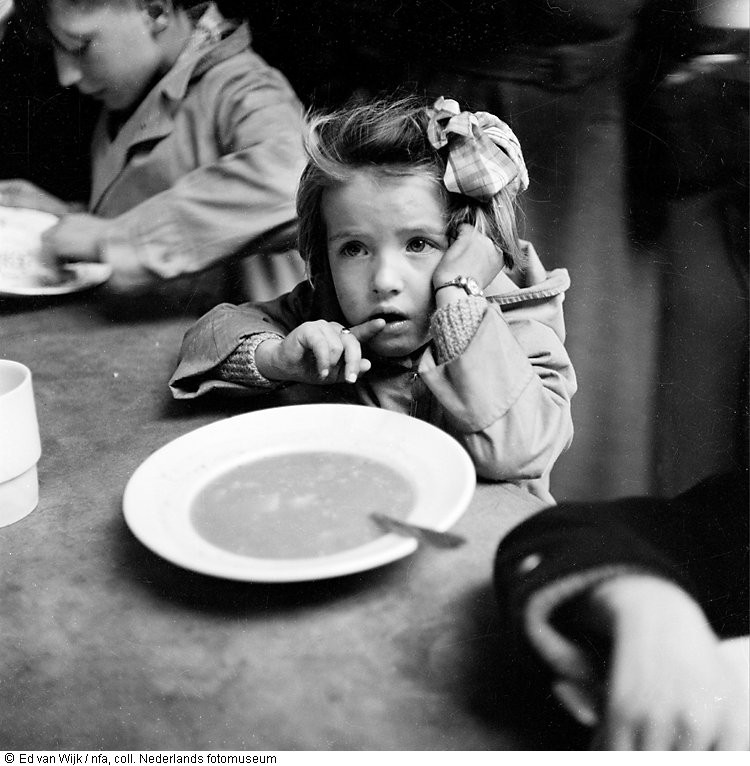 Girl eating soup in shelter after the flood, New Zealand (1953)