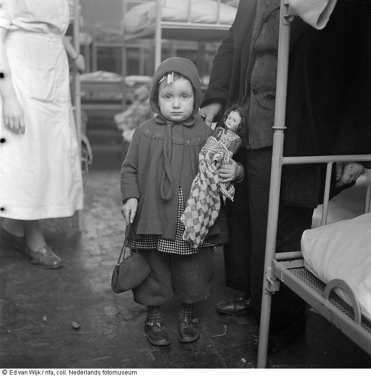 Evacuated child with doll in dormitory just after the flood, New Zealand (1953)